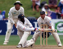 Trevor Madondo sweeps during his 74, New Zealand v Zimbabwe, Only Test, Wellington, 4th day, December 29, 2000