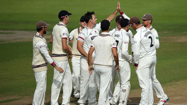 Somerset celebrate another wicket on the first morning