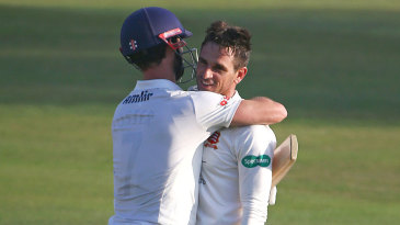 James Foster embraces Ryan ten Doeschate as the Division Two title is clinched