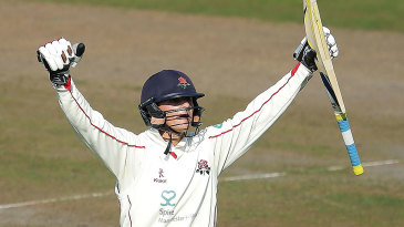 Rob Jones celebrates his maiden first-class hundred