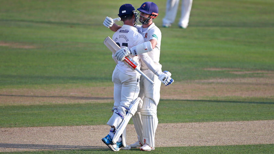 James Foster and Ryan ten Doeschate embrace as Essex achieve promotion