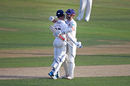 James Foster and Ryan ten Doeschate embrace as Essex achieve promotion from Division Two of the Championship, Essex v Glamorgan, Specsavers Championship Division Two, Chelmsford, September