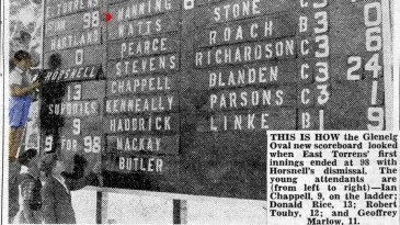 A clipping from the <i>Adelaide Advertiser</i> on the Glenelg Oval scorecard. Nine-year-old Ian Chappell stands on a ladder to make changes