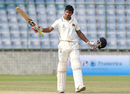 Kaustubh Pawar raises his bat after scoring a hundred, Mumbai v New Zealanders, tour match, 2nd day, Delhi, September 17, 2016