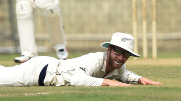 Kane Williamson looks after attempting a futile dive to stop the ball