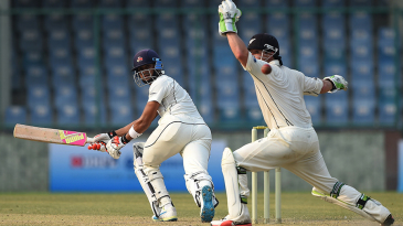 Aditya Tare steers the ball past BJ Watling on the leg side
