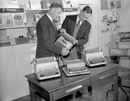 Alec (left) and Eric Bedser look at typewriters in their office equipment store in Woking, October 11, 1955