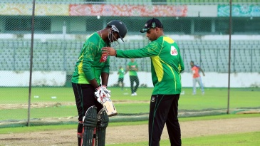 Bangladesh batting consultant Thilan Samaraweera helps Alauddin Babu with his stance