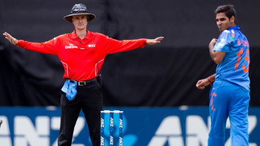 Bhuvneshwar Kumar looks back as umpire Billy Bowden signals a wide