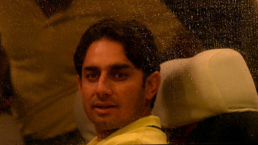 Saeed Ajmal looks out of the window of the team bus