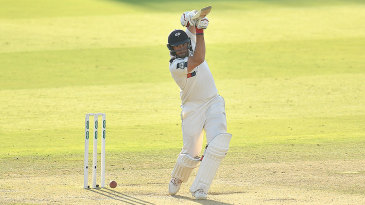 Tim Bresnan drives through the covers
