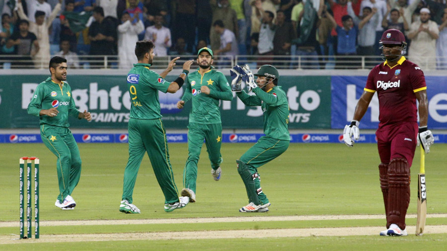 Imad Wasim is congratulated after dismissing Andre Fletcher