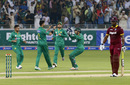 Imad Wasim is congratulated after dismissing Andre Fletcher, Pakistan v West Indies, 1st T20I, Dubai, September 23, 2016