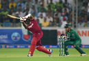 Jerome Taylor drives down the ground, Pakistan v West Indies, 1st T20I, Dubai, September 23, 2016