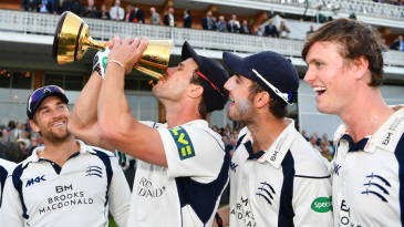 Nick Compton enjoys a drink for the Championship trophy