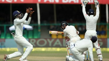 India go up in appeal for the wicket of Mitchell Santner