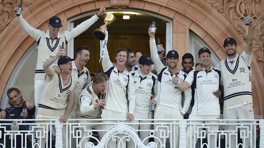 The Middlesex players celebrate on the balcony