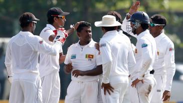 Rangana Herath celebrates a wicket with his team-mates