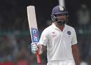 Rohit Sharma raises his bat after reaching fifty, India v New Zealand, 1st Test, Kanpur, 4th day, September 25, 2016