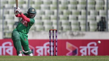 Imrul Kayes drives through cover