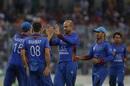 Mirwais Ashraf is mobbed by his team-mates, Bangladesh v Afghanistan, 1st ODI, Mirpur, September 25, 2016