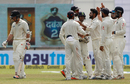 Team-mates gather round Ravindra Jadeja after Luke Ronchi's dismissal, India v New Zealand, 1st Test, Kanpur, 5th day, September 26, 2016