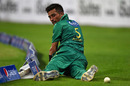 Mohammad Amir looks back after he could not stop the ball, Pakistan v West Indies, 3rd T20I, Abu Dhabi, September 27, 2016