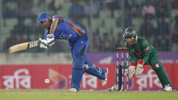Afghanistan captain Asghar Stanikzai clips one to the leg side