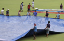 Groundsmen cover the field at Eden Gardens a day before the second Test, Kolkata, September 29, 2016