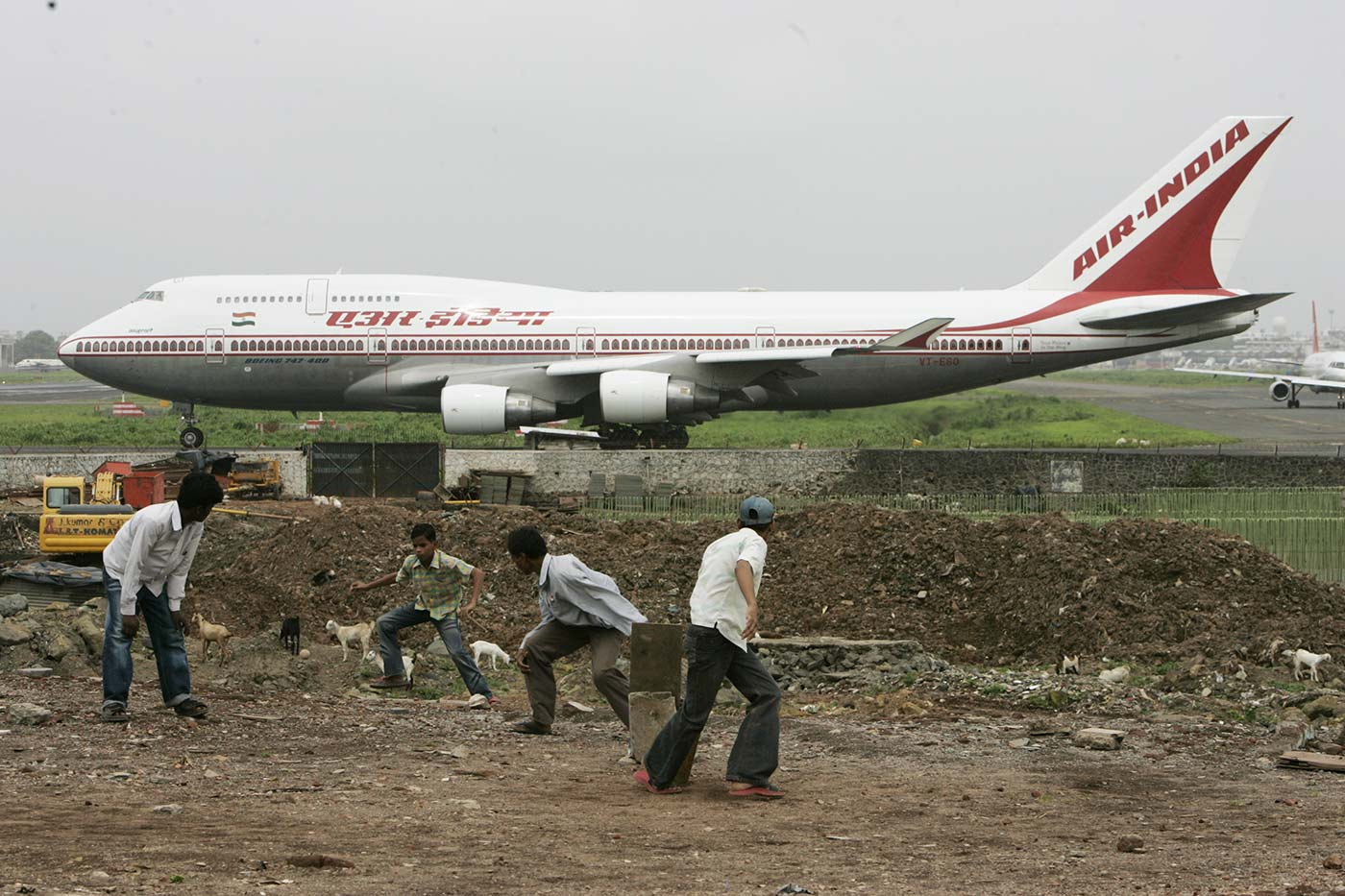 A game of cricket against the backdrop of an airplane