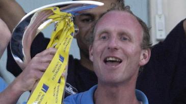 Kent captain Matthew Fleming lifts up the Norwich Union League trophy
