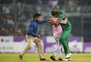 A security official grabs a fan who barges into the field and hugs Mashrafe Mortaza, Bangladesh v Afghanistan, 3rd ODI, Mirpur, October 1, 2016