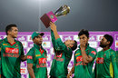 Nasir Hossain checks out Bangladesh's trophy, Bangladesh v Afghanistan, 3rd ODI, Mirpur, October 1, 2016