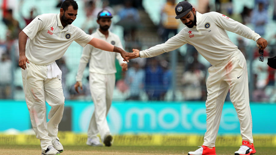 Mohammed Shami reaches out to high five his captain
