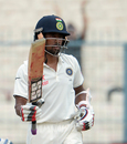Wriddhiman Saha raises his bat after scoring his second fifty of the match, India v New Zealand, 2nd Test, Kolkata, 4th day, October 3, 2016