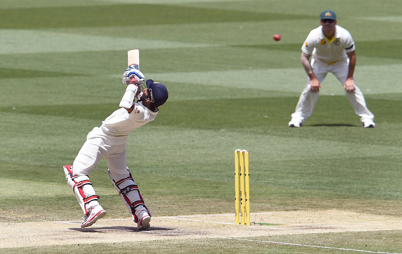 Full tilt: Rahane tries, unsuccessfully, to bunt Johnson over the slips at the MCG