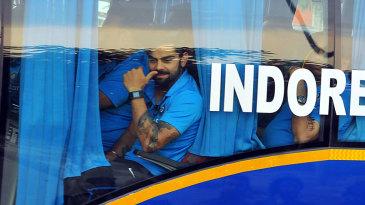 Virat Kohli peers out of the team bus