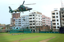 A helicopter hovers over the Academy ground near the Shere Bangla National Stadium  on the eve of the first ODI between Bangladesh and England, Mirpur, October 6, 2016