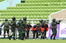 Security personnel  and commandos conduct a mock drill at the Shere Bangla National Stadium  on the eve of the first ODI between Bangladesh and England, Mirpur, October 6, 2016