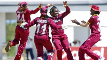 Deandra Dottin celebrates one of her three wickets