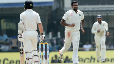 R Ashwin celebrates the wicket of Luke Ronchi, his fourth of the day
