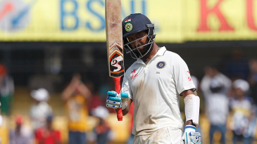Cheteshwar Pujara acknowledges the applause after scoring his half-century