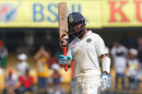 Cheteshwar Pujara acknowledges the applause after scoring his half-century, India v New Zealand, 3rd Test, Indore, 4th day, October 11, 2016