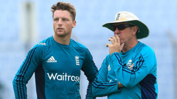 Jos Buttler and Trevor Bayliss chat during training