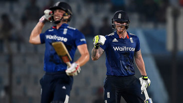 Chris Woakes and Ben Stokes celebrate the winning moment