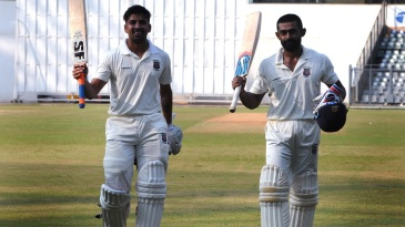 Swapnil Gugale and Ankit Bawne walk off after their record-breaking partnership