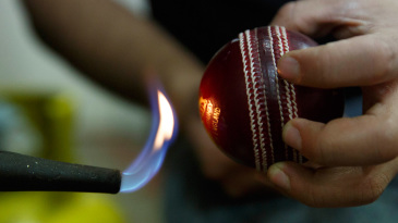 The ball is lamped where grease is melted onto the ball prior to polishing at the Morrant Sport factory that finishes off the Duke cricket ball in Walthamstow