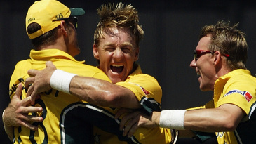 Andy Bichel celebrates a wicket