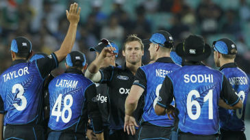 Doug Bracewell celebrates the wicket of Rohit Sharma