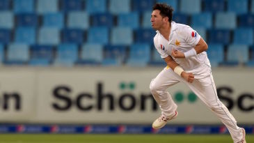 Yasir Shah looks on after delivering the ball